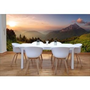 Vlies fotobehang Zonsondergang in de bergen